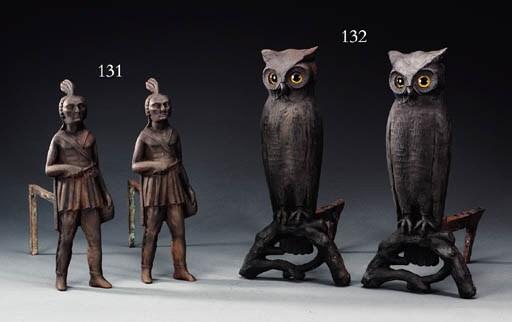 A PAIR OF CAST IRON OWL ANDIRO