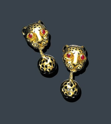 A GOLD, RUBY AND BLACK ENAMEL