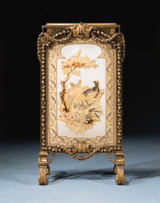 A carved giltwood fire-screen