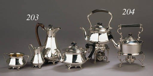 An English silver kettle on st