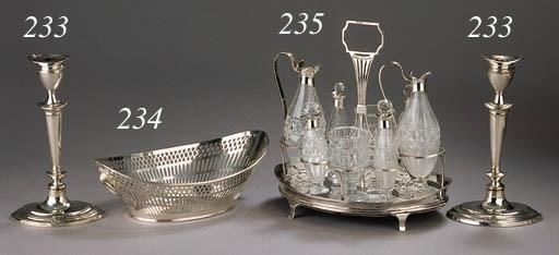 An English silver cruet stand