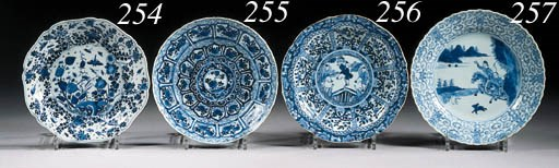 A set of four blue and white p