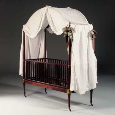 A REGENCY MAHOGANY CHILD'S BED