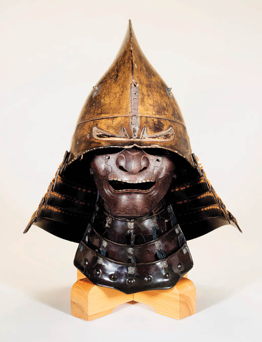 AN EBOSHI-NARI KABUTO [HELMET IN THE FORM OF A COURT CAP] AND A ...