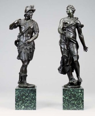 A PAIR OF BRONZE ANDIRON FIGUR