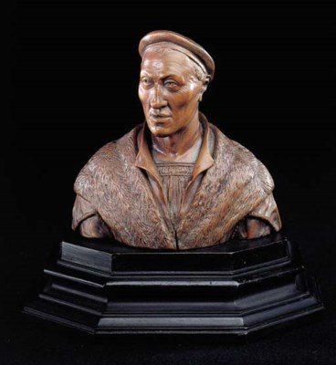 A CARVED BOXWOOD BUST OF A CLE