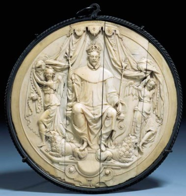 A CIRCULAR IVORY RELIEF OF A F