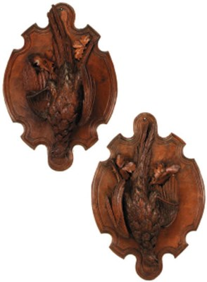 A pair of Black Forest carved