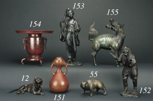 A Japanese bronze figure of a
