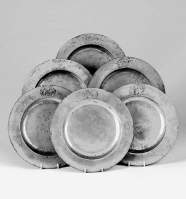 A set of six pewter plates, mi