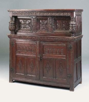 A carved oak press cupboard, N