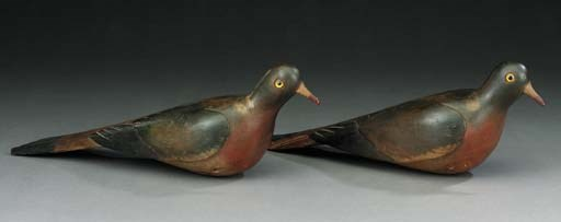 A pair of polychrome carved wo