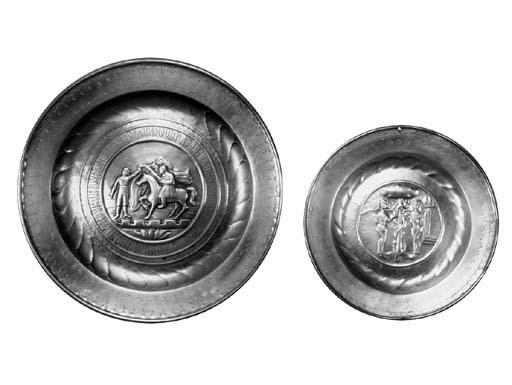 A Nuremburg brass alms dish, 1