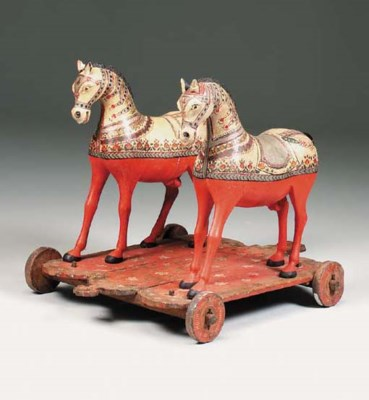 An Indian polychrome carved wo