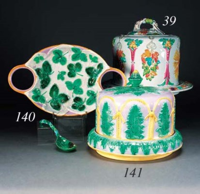 An majolica cheese bell and co