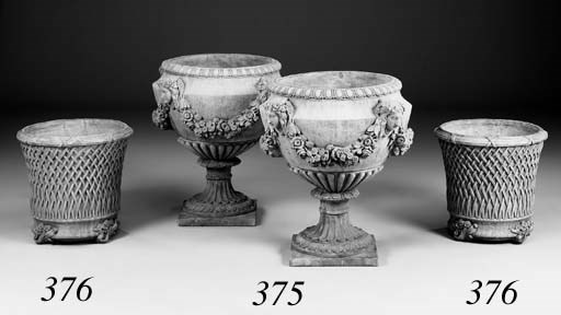A pair of terracotta urns, of