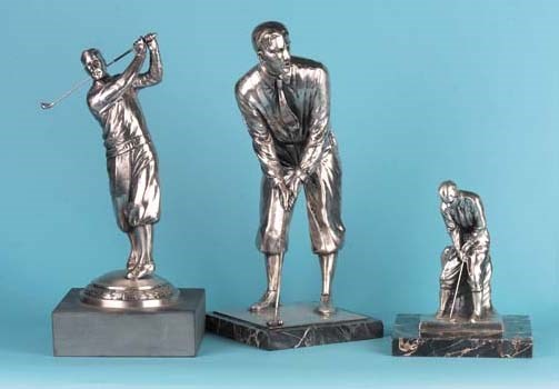 A WHITE METAL FIGURE OF A GOLF