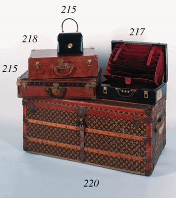 A briefcase of black leather,
