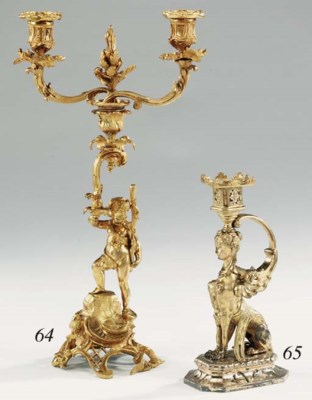 A Victorian gilt bronze twin l