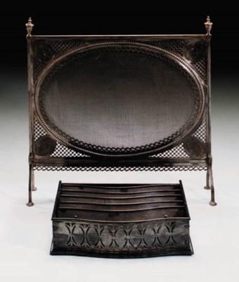 A polished steel firescreen, e