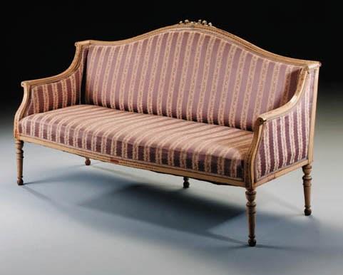 A cream and decorated sofa, la
