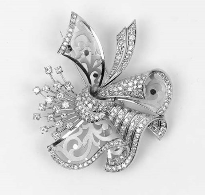 A diamond cluster clip brooch,