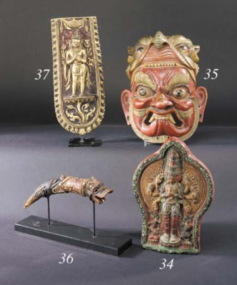 A Tibetan wood painted mask de