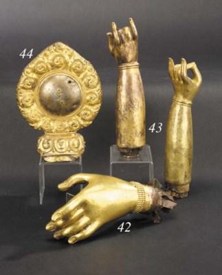 A Tibetan gilt bronze hand of
