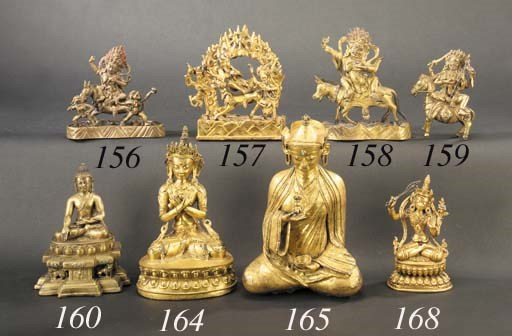 A Tibetan gilt-bronze model of