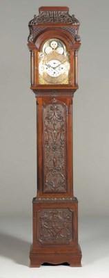 An Edwardian carved mahogany q