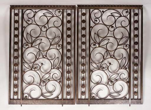 A PAIR OF WROUGHT-IRON RADIATO