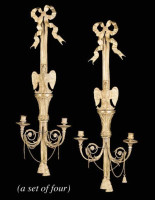 A set of four gilt bronze twin