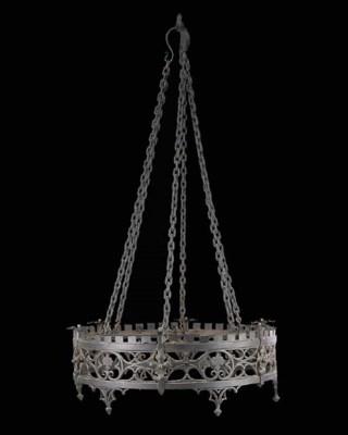 A wrought iron chandelier, cir