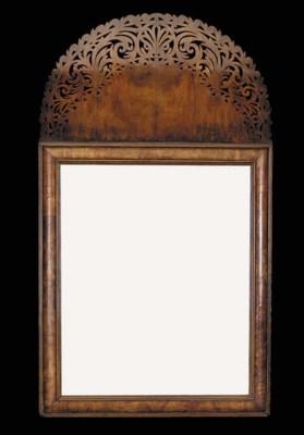 A walnut cushion frame mirror,