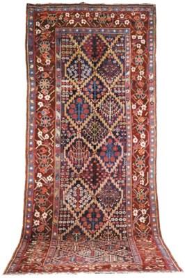 An antique Bijar long kelleh