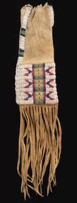 A PLAINS CHILD'S BEADED AND FR