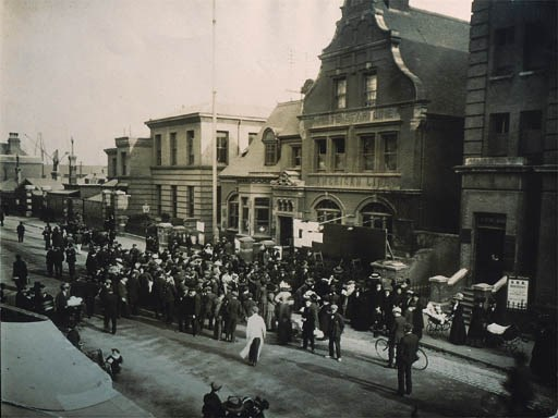 A Photograph Of Crowds In Fron