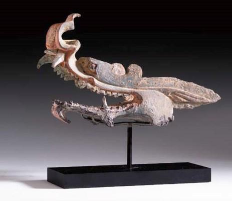 A Rare Painted Lead Dragon Hea