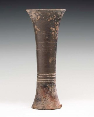 An Early Black Pottery Beaker,