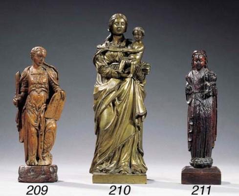A carved wood allegorical fema