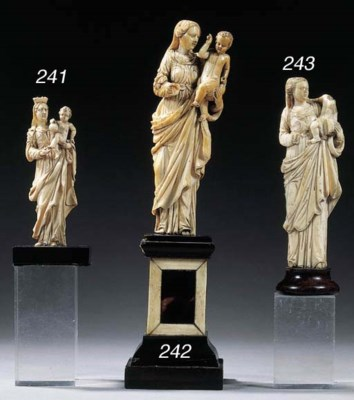 A carved ivory group of the Vi