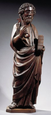 A carved wood figure of St. Pe