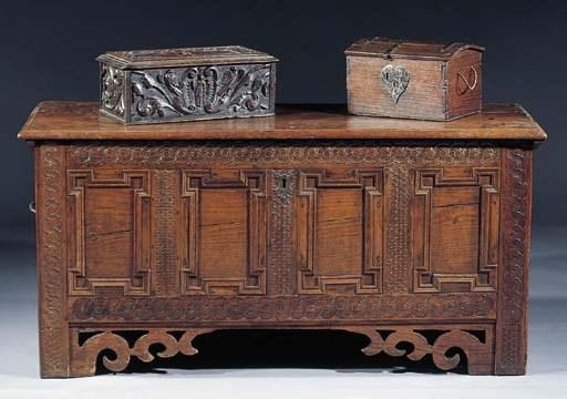 A carved oak casket