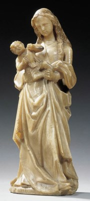 A carved alabaster group of th