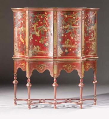 A red and gilt-japanned cabine
