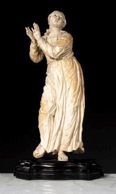 A carved ivory female figure