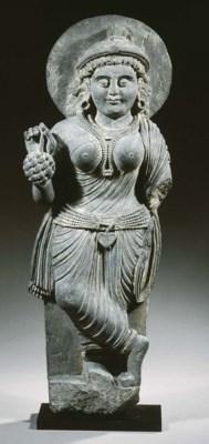 a rare gandhara schist figure