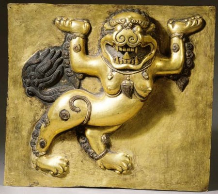 a tibetan gilt-copper panel