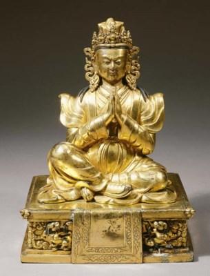 a rare tibetan gilt-bronze fig