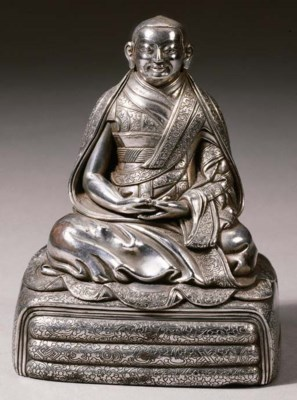 a fine tibetan silver figure o